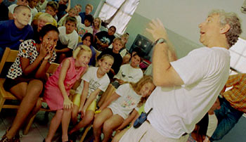 Jay Pasachoff of Williams College talks to elementary student of Aruba prior to the Total Solar Eclipse in 1998. Photo by Mark D Phillips