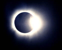 The diamond ring begins the total phase of the eclipse of the sun on Wednesday, Aug. 11, 1999. Photo by Richard Horwitz.